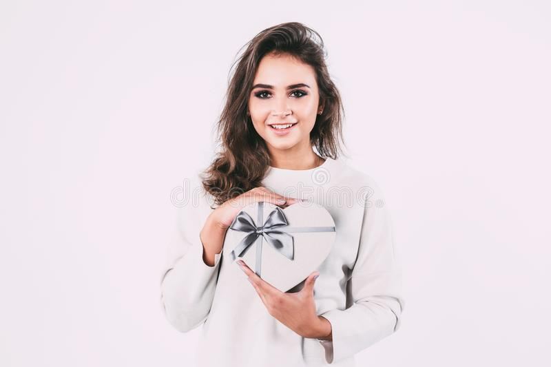 Beautiful smiling woman with gift box. royalty free stock photos