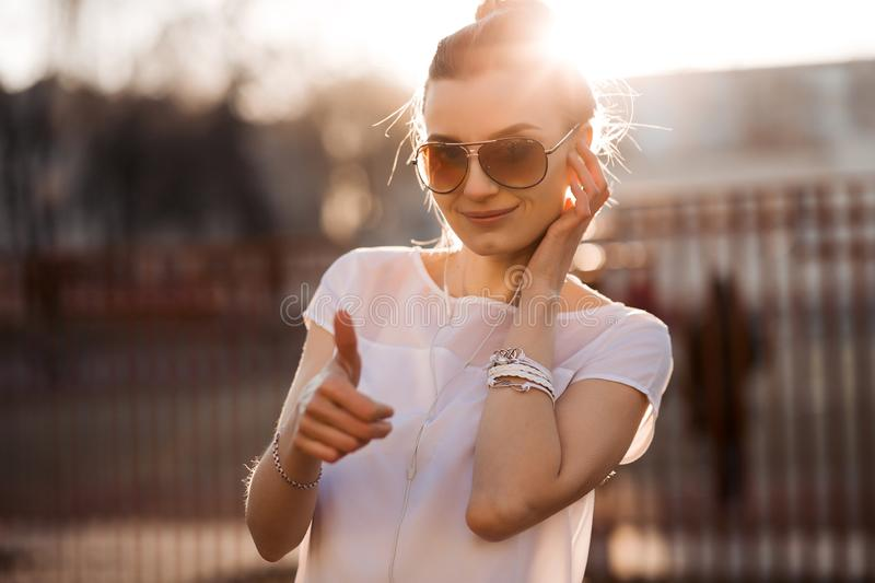 Beautiful smiling woman listening music and gesturing super. royalty free stock images