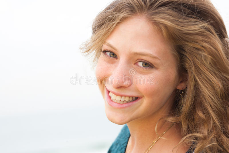 Beautiful smiling woman outdoor portrait royalty free stock photo