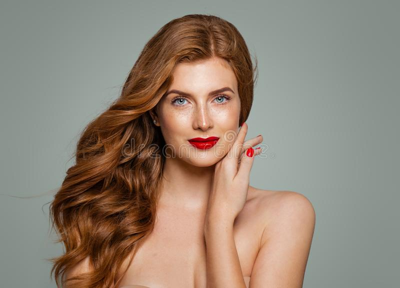 Beautiful smiling woman portrait. Elegant redhead girl with curly hairstyle stock images