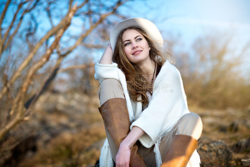 Beautiful smiling woman relaxing outdoors royalty free stock images