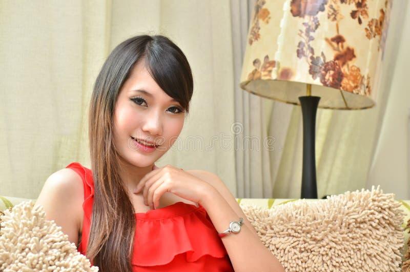 Download Beautiful Smiling Woman Sitting On Modern Sofa Royalty Free Stock Photos - Image: 25690658