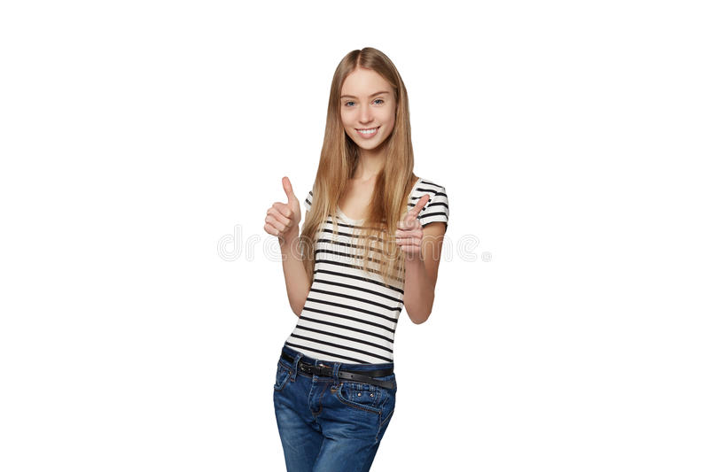 Beautiful smiling woman standing in full length over white backg. Round and giving double thumb up royalty free stock images