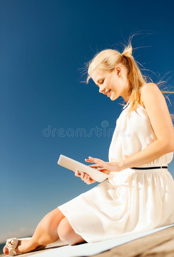 Download Beautiful Smiling Woman With Tablet Pc Outdoors Stock Image - Image: 33079655