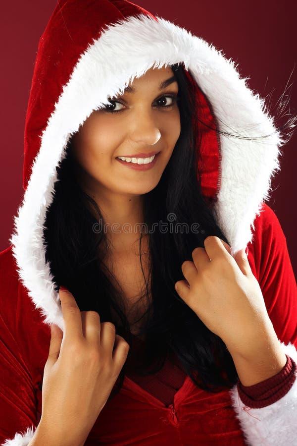 Beautiful smiling woman wearing santa clause costume stock image