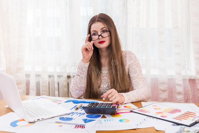 Beautiful smiling woman work with business graphs royalty free stock photography