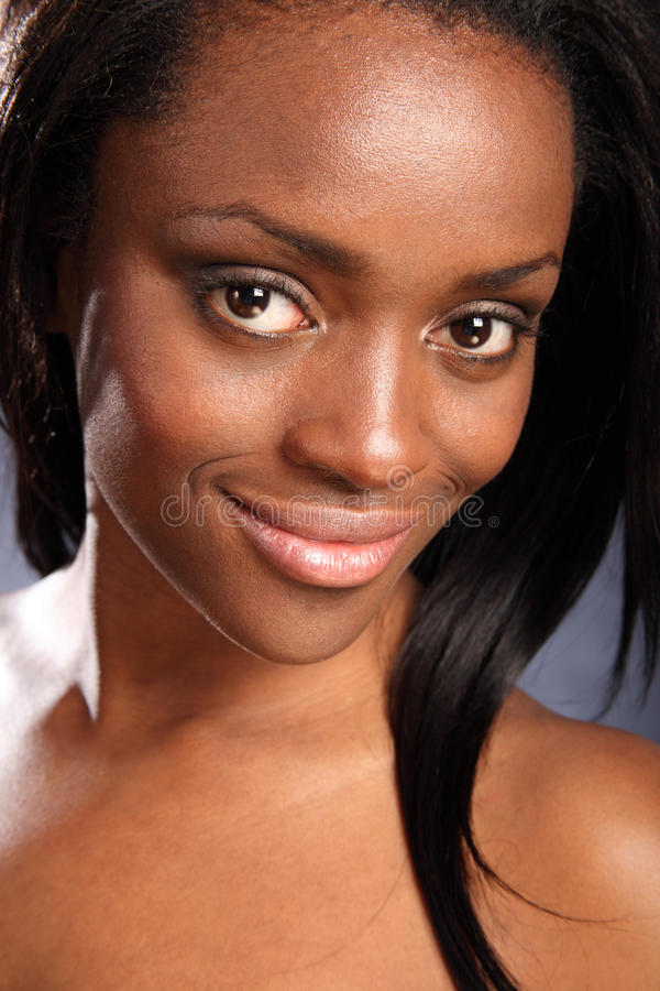 Beautiful smiling young african american woman royalty free stock photo