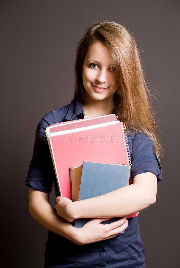 Beautiful smiling young student girl. royalty free stock photography
