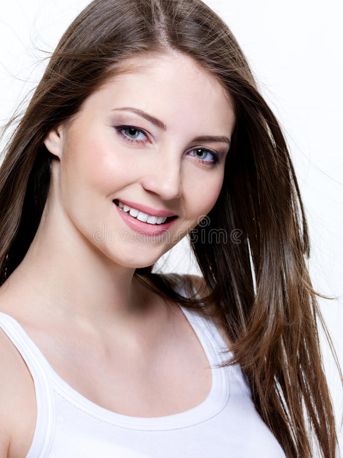 Beautiful smiling young woman royalty free stock image