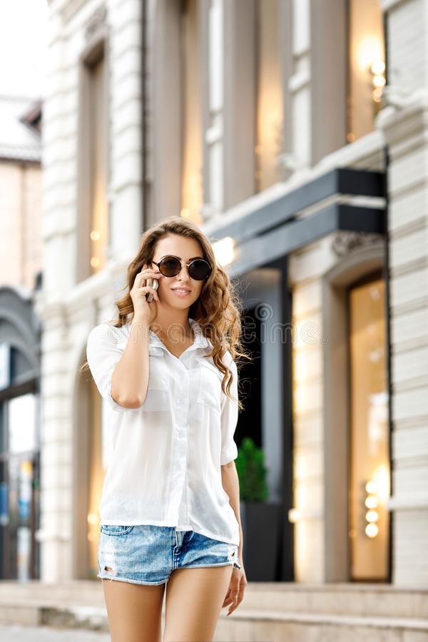 Young woman talking on the phone royalty free stock image