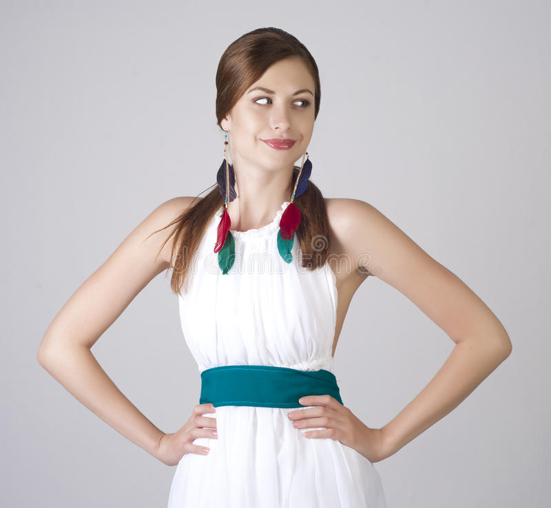 Beautiful smiling young woman in white dress royalty free stock image