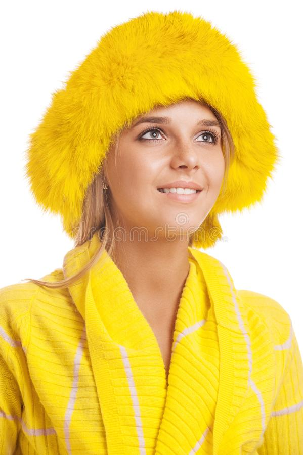 Beautiful smiling young woman in yellow fur hat stock photos