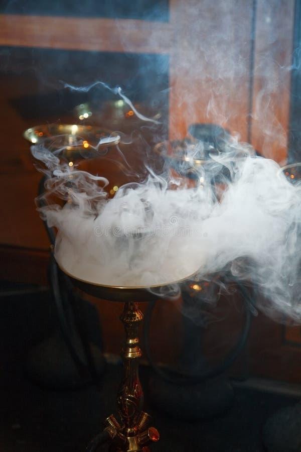 Hookah. Beautiful smoke in the bowl of a hookah. close-up stock image