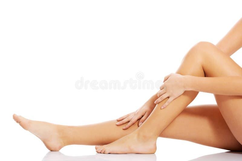 Beautiful, smooth female legs. stock photos