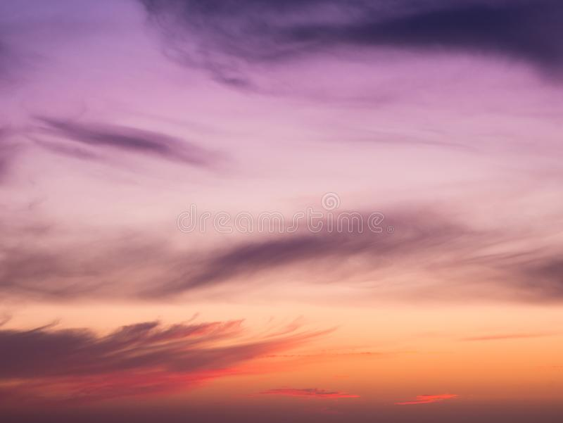 Beautiful smooth gradient sky, purple and red at sunset with soft, wispy clouds stock photos