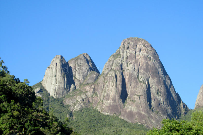 Beautiful smooth rock in green forest. Beautiful scenery of green forest and smooth rocks. Tres Picos, three peaks isolate mountain ofSerra dos Orgaos royalty free stock image