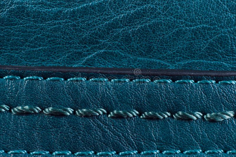Beautiful smooth seam on the blue leather bag, close-up.  stock images