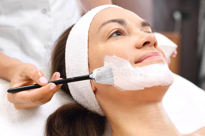 Beautiful and smooth skin, professional care in a beauty salon. royalty free stock photo