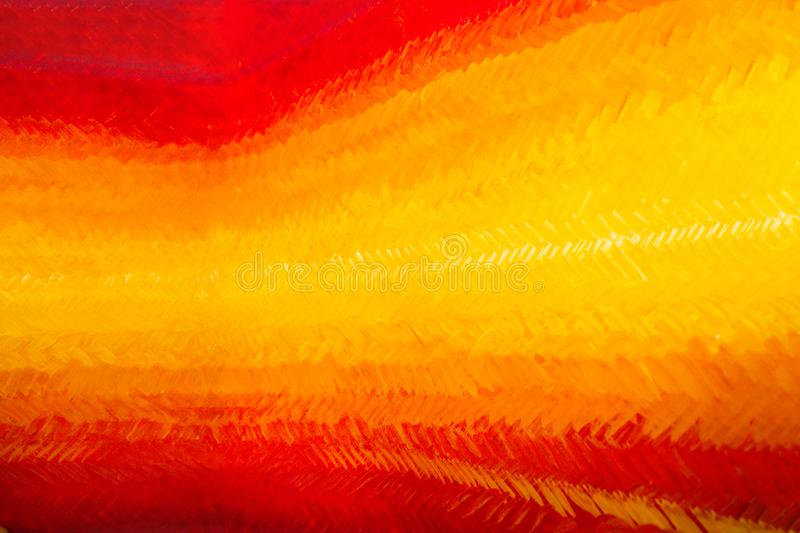 Gdaddientny background with visible brush strokes. Brush strokes form herringbone pattern. A beautiful smooth transition from red to yellow and back royalty free stock photography