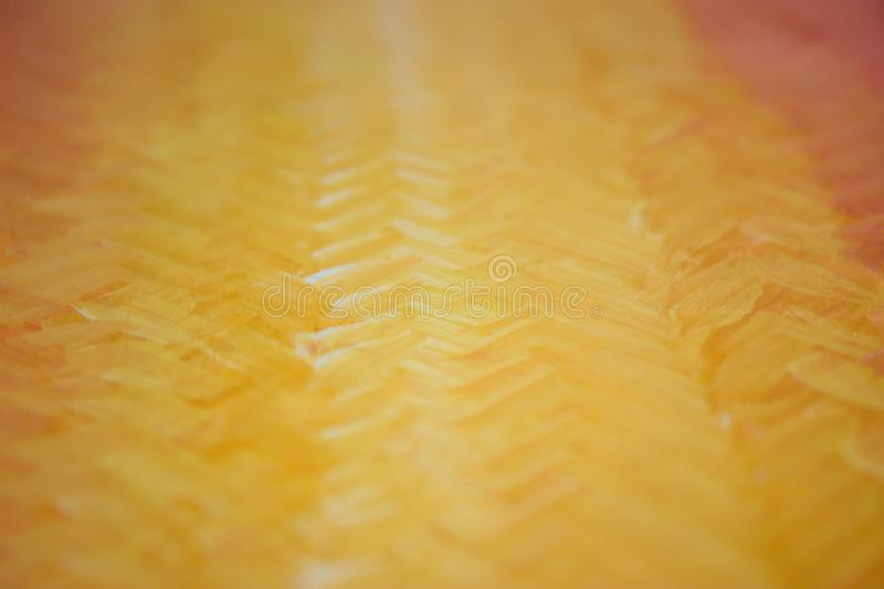 Gdaddientny background with visible brush strokes. Brush strokes form herringbone pattern. A beautiful smooth transition from red to yellow and back royalty free stock photo