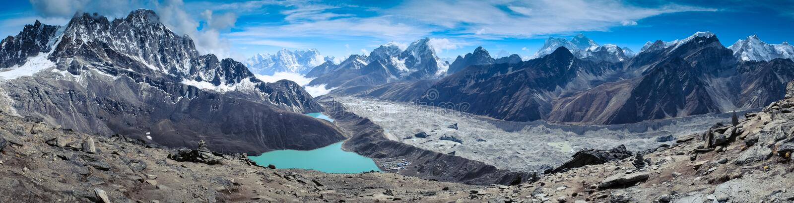 Beautiful snow-capped mountains with lake royalty free stock image