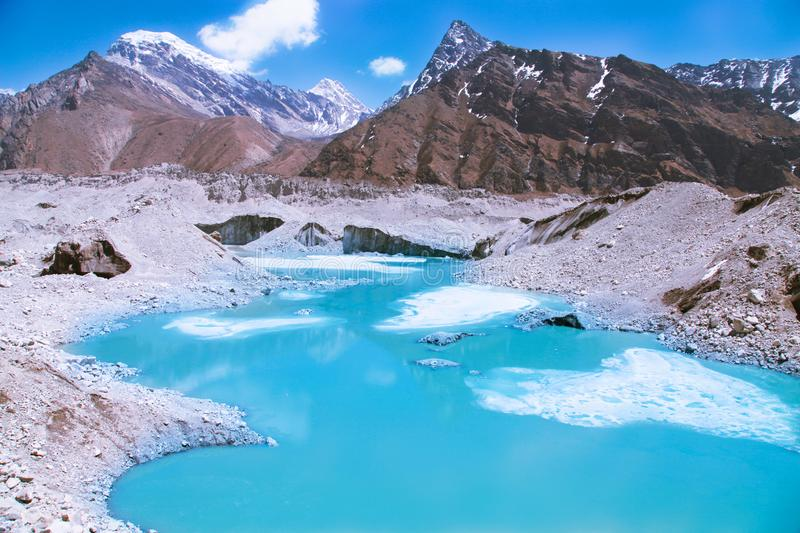 Beautiful snow-capped mountains with lake against the blue sky. Himalaya, Nepal stock images