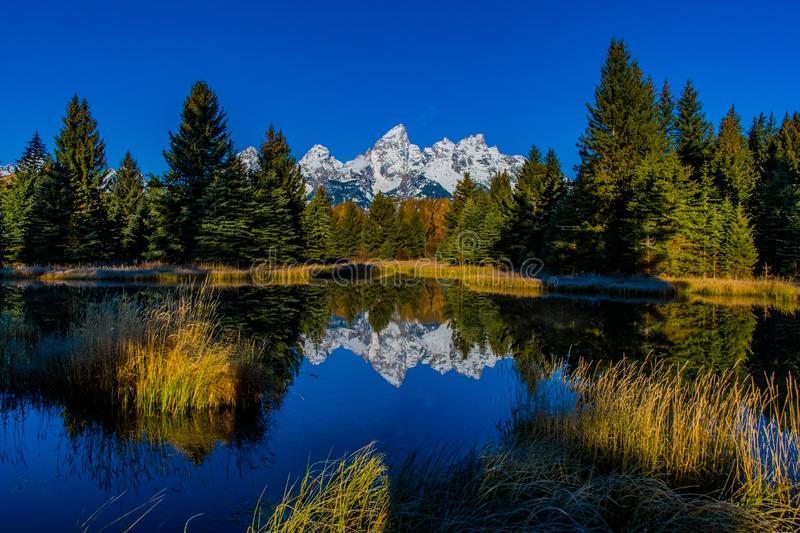 Beautiful Snow-capped Mountains at Schwabacher`s Landing in Late Autumn stock image