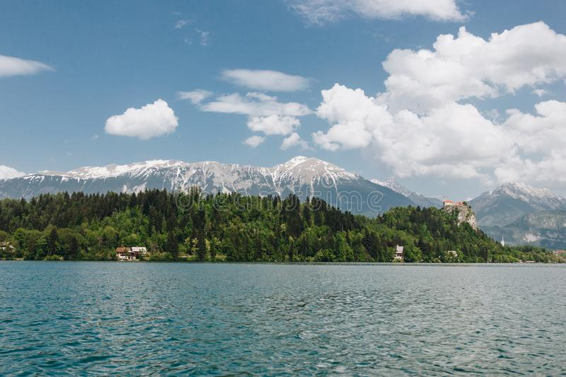 Beautiful snow-covered mountain peaks, green vegetation and calm lake,. Bled, slovenia royalty free stock photos