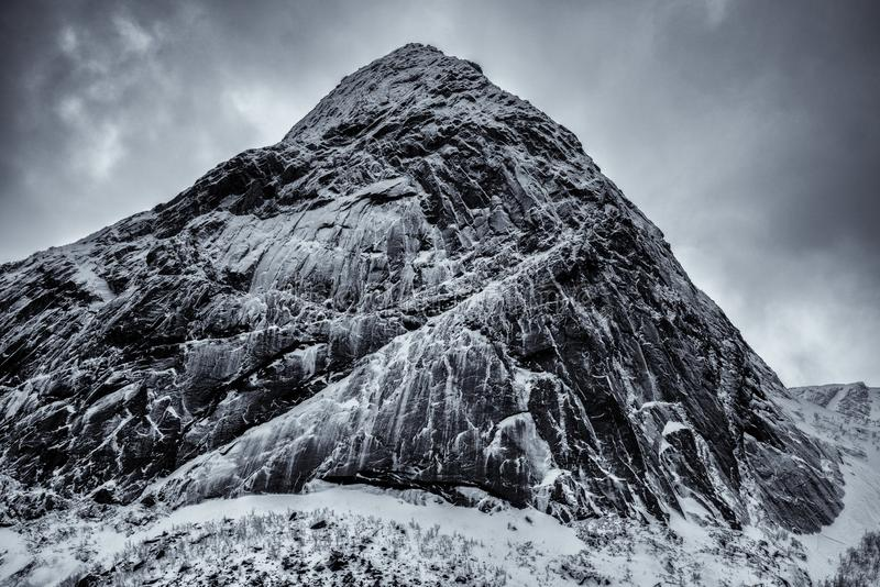 The epic snow covered mountains of the Lofoten Islands. Reine, Norway royalty free stock image