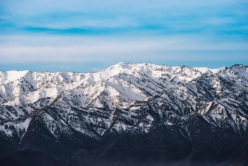 Beautiful snow-covered mountains in winter in sunny weather in Leh, Ladakh, India. stock images