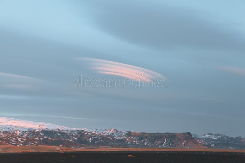 Beautiful snow-covered rocky mountains and cloudy sky. In iceland stock photo