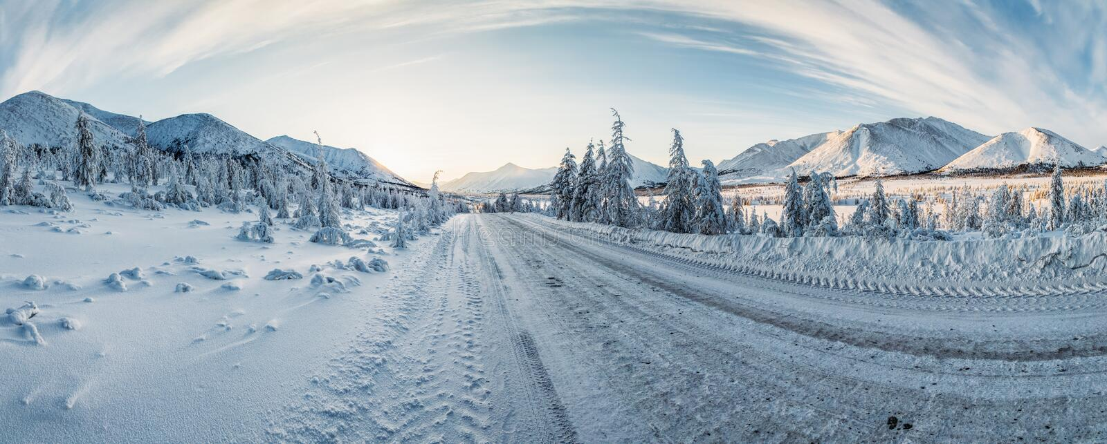 Beautiful snow covered winter road and trees in scenic mountains, kolyma highway,. Russian federation royalty free stock image