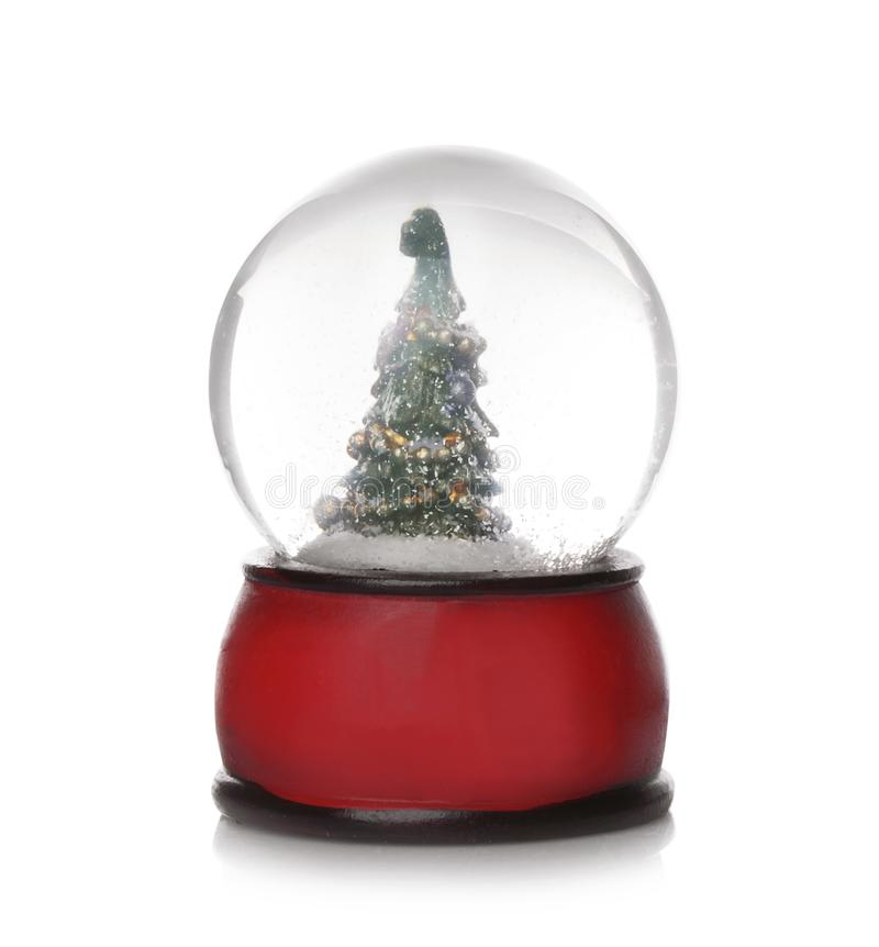 Beautiful snow globe with Christmas tree inside on white royalty free stock photography