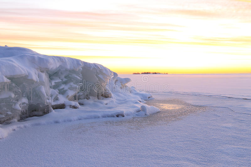 Beautiful snow landscape with colorful dawning sky. Karelia, Russia royalty free stock photography