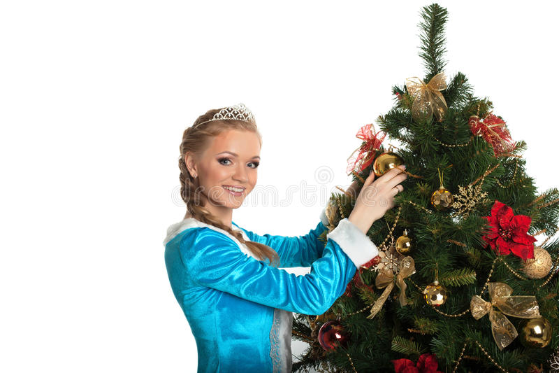 Beautiful Snow Maiden decorating Christmas tree stock photos