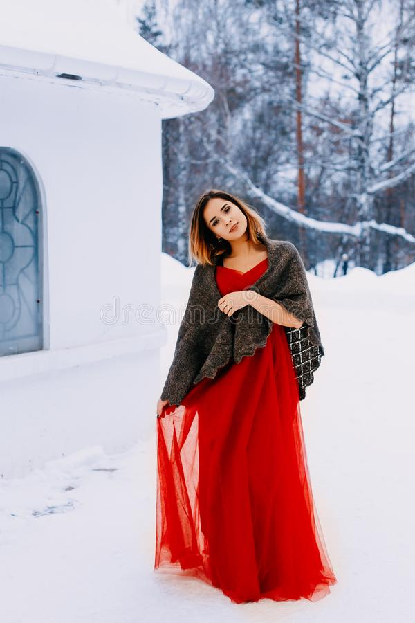 Beautiful snow maiden girl with red hair on february nature. Snow fall in february. Long retro gown. Beautiful snow maiden girl with red hair on february nature stock photography