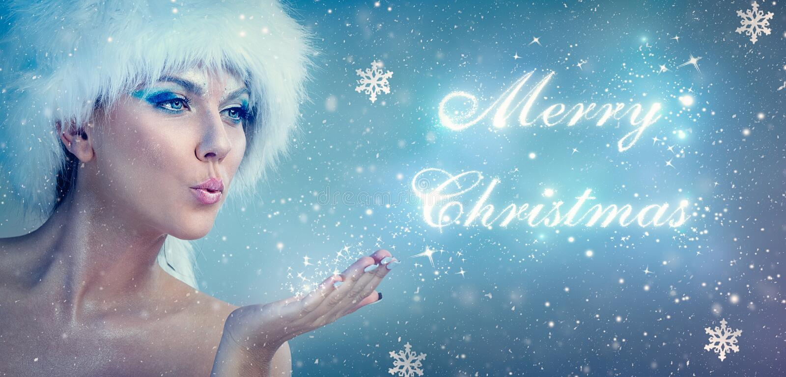 Snow queen blowing merry christmas royalty free stock photos