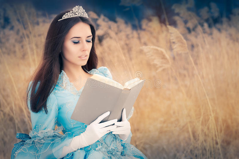 Beautiful Snow Queen Reading a Book royalty free stock image
