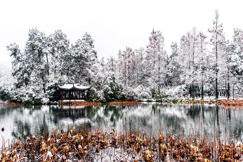 The beautiful Snow winter landscape scenery of Xihu West Lake and pavilion with garden in Hangzhou China stock image