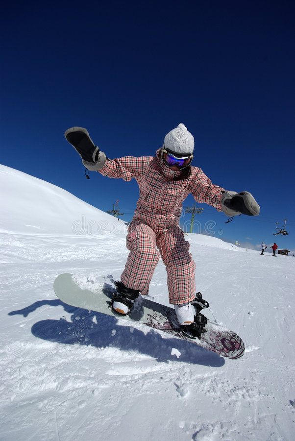 Beautiful snowboarder jumping royalty free stock photography