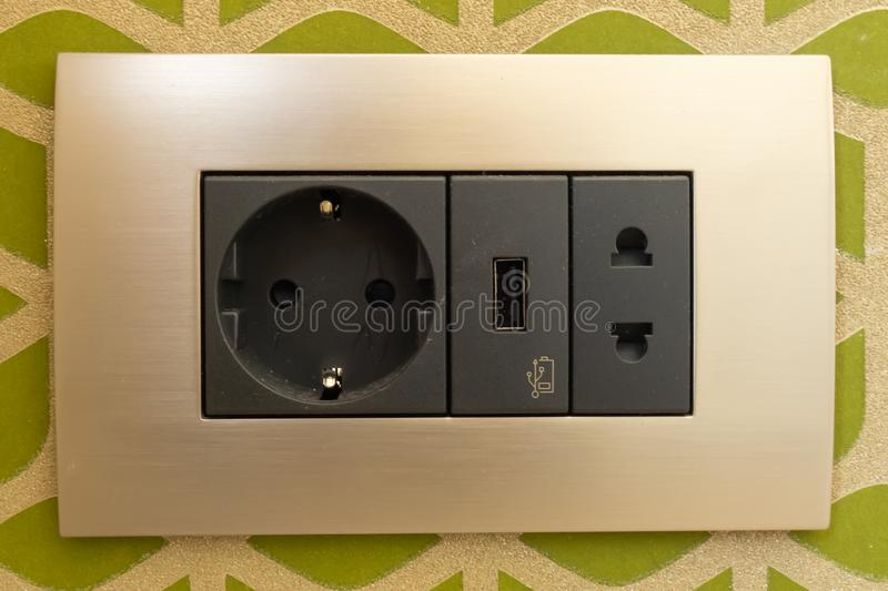 Beautiful sockets and black switches in various combinations with an aluminum frame. USB port. Close, closeup, modern, house, home, wall, empty, blank, light royalty free stock image