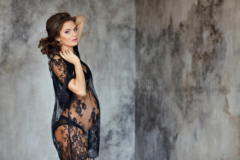 Beautiful soft and sensual pregnant woman in black transparent d stock photo