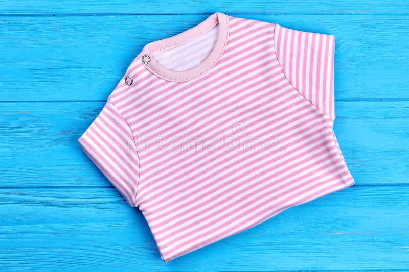Beautiful soft shirt for baby-girl. New striped cotton apparel for infant girl. New collection of summer cotton clothes for infant girls stock photography