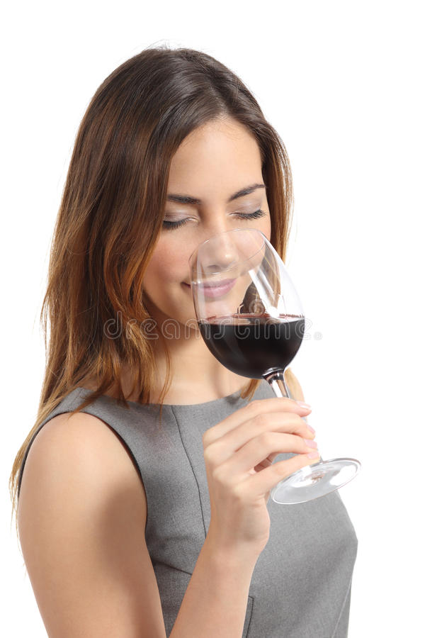 Beautiful sommelier woman tasting wine royalty free stock images