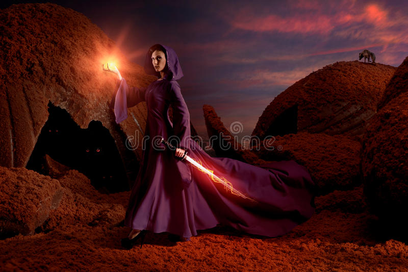 Beautiful sorceress in chocolate landscape royalty free stock image
