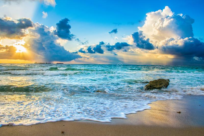 Beautiful South Florida Sunrise. Beautiful South Florida Fort Lauderdale Beach Sunrise with Colorful Skies and boulder in the ocean stock image