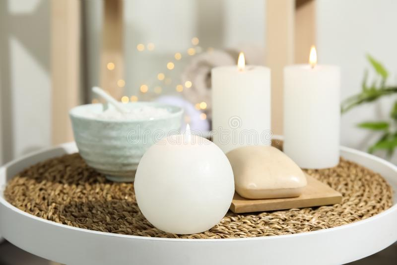 Beautiful spa composition with candles and cosmetic. On table royalty free stock photo