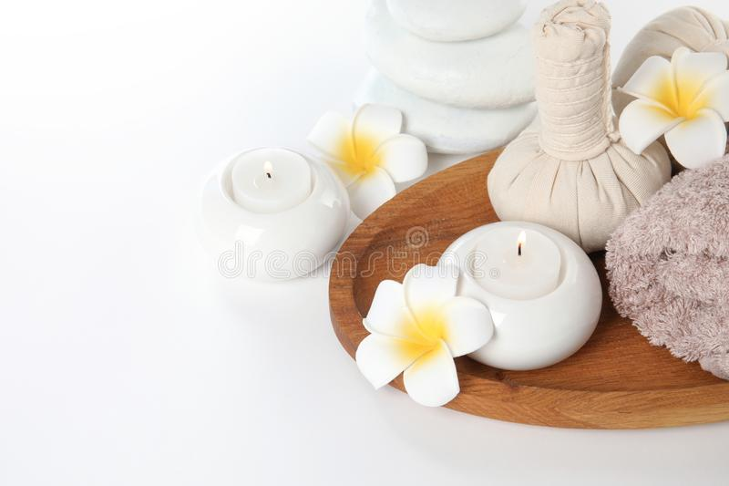 Beautiful spa composition with candles and flowers. On white background stock images