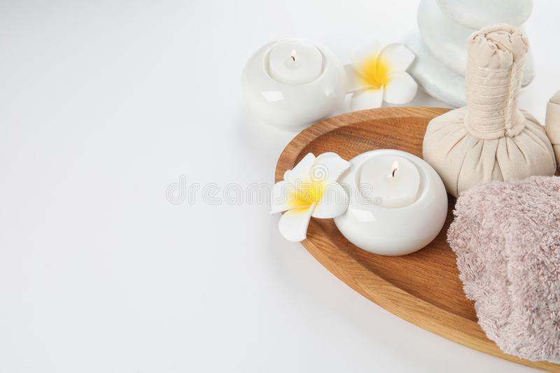 Beautiful spa composition with candles and flowers. On white background royalty free stock images