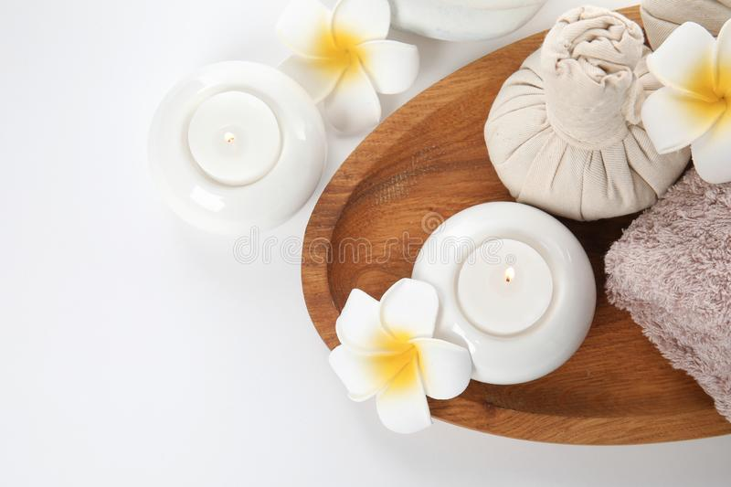 Beautiful spa composition with candles and flowers on white background. Top view stock photos